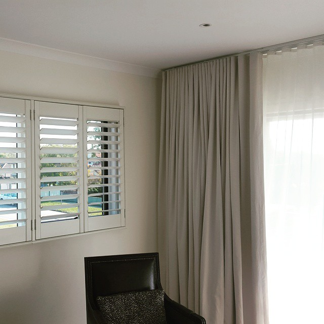 Combination of curtains and plantation shutters