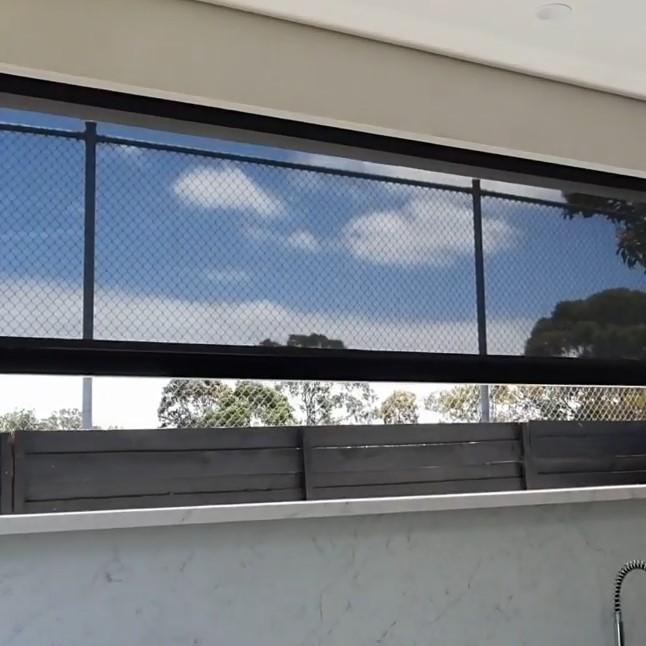 Outdoor motorized roller blinds